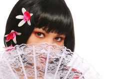 Brunette with lace fan and beautiful flowers in her black bob hair over white. geisha Stock Image