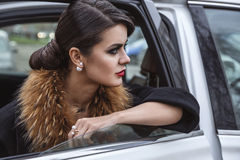 Brunette lady in the car. Stock Photography