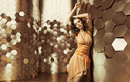 Brunette lady dancing in the shiny room stock image