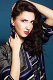 Brunette lady with feather earring. Brunette girl with feather earring royalty free stock image