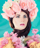 Brunette lady with floral wreath on her head. Royalty Free Stock Images