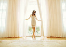 Brunette lady having amazing shapely legs Royalty Free Stock Images