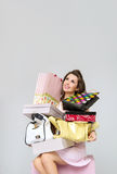 Brunette lady with heap of fashion accesories stock photos