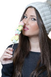 Brunette lady holding a candy skewer Royalty Free Stock Photography
