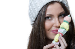 Brunette lady holding a candy skewer Royalty Free Stock Photo