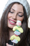 Brunette lady holding a candy skewer Stock Photos