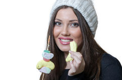 Brunette lady holding a candy skewer Stock Image