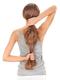 Brunette lady holding long hairs from back Stock Photo
