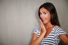 Brunette lady looking surprised at camera Stock Photo