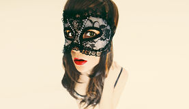 Brunette lady in masquerade mask. carnival party Stock Photos