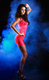 Brunette lady posing in studio Royalty Free Stock Photography