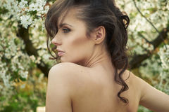 Brunette lady realxing in the orchard Royalty Free Stock Photos