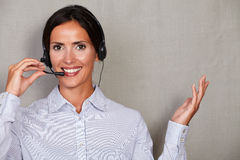 Brunette lady secretary speaking through headset Stock Photography