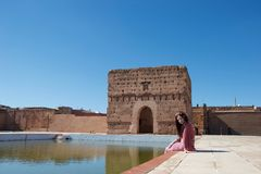 A lady smiling by a pond in Morocco stock images