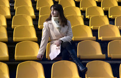Brunette lady on a stadium tribune Royalty Free Stock Photography