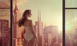 Brunette lady staring at beautiful sunrise Stock Photos