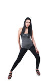 Brunette lady wear black leggings, leotard and wedge sandals Royalty Free Stock Photography