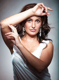 Brunette lady in white singlet Royalty Free Stock Images