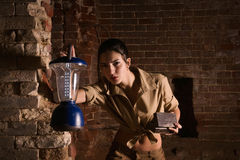 Brunette with a lantern search treasure in the ruins Royalty Free Stock Photos