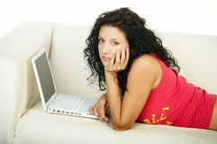 Brunette with laptop Royalty Free Stock Image