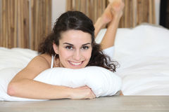 Brunette laying in bed Royalty Free Stock Photos