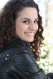 Brunette in leather jacket Stock Photos