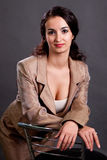 Brunette in a light business suit Stock Image