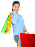 Brunette Like Shopping. Young attractive woman carrying shopping bags. isolated stock photography