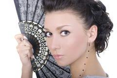 Brunette lindo con el ventilador Foto de archivo libre de regalías