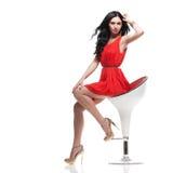 Brunette lindo na cadeira Imagens de Stock
