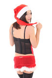 Brunette in lingerie and santa hat over white Stock Photography