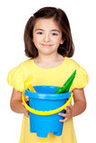 Brunette little girl with beach toys Stock Image