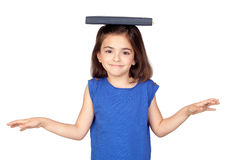 Brunette little girl with a book on her head Royalty Free Stock Image