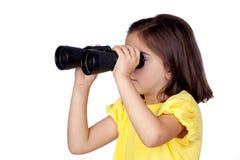 Brunette little girl looking through binoculars Royalty Free Stock Image