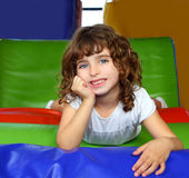 Brunette little girl portrait posing in playground Stock Image