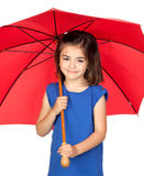 Brunette little girl with a red umbrella Stock Photo