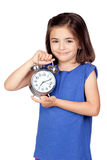 Brunette little girl with a silvered alarm-clock Stock Photos