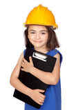 Brunette little girl with a yellow helmet Stock Image