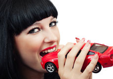 Brunette with a little red car Royalty Free Stock Photography
