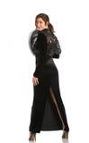 Brunette in long black dress Stock Photography