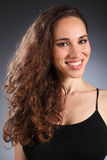 Brunette long brown curly hair of beautiful woman Royalty Free Stock Photos