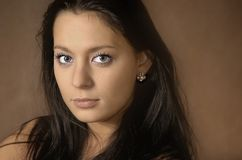 The brunette with long hair royalty free stock photography