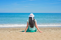 Brunette with long hair turned away Stock Images