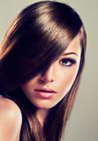Brunette with long straight hair. Royalty Free Stock Photography