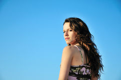 Brunette longhaired girl over the blue sky Royalty Free Stock Photos