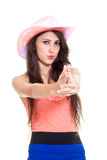 Brunette longhaired woman shooting with fingers. Royalty Free Stock Images