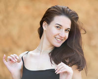 Brunette looking at camera smiling Royalty Free Stock Photos