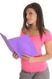 Brunette looking at a folder. Shot of a brunette looking at a folder Stock Images