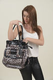Brunette looking in her bag stock photo