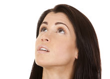 Brunette looking up. Close up on brunette's face as she is looking up Stock Images